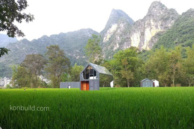 A Chinese made prefabricated resort for Asia in place below majestic mountains.